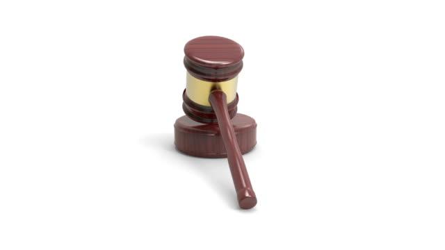 wooden judge gavel and soundboard rotate on white background - asta oggetto creato dall'uomo video stock e b–roll