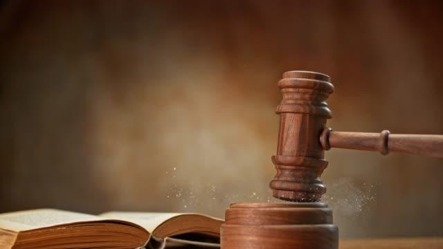 SLO MO LD Wooden judge's gavel striking the dusty sound block video