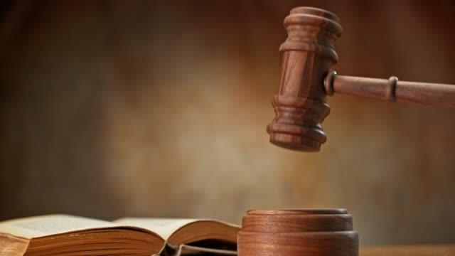 SLO MO LD Wooden judge's gavel striking the wooden block video
