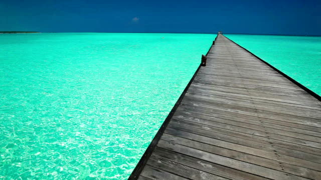 Wooden long jetty over lagoon in Maldives with amazing clean water video
