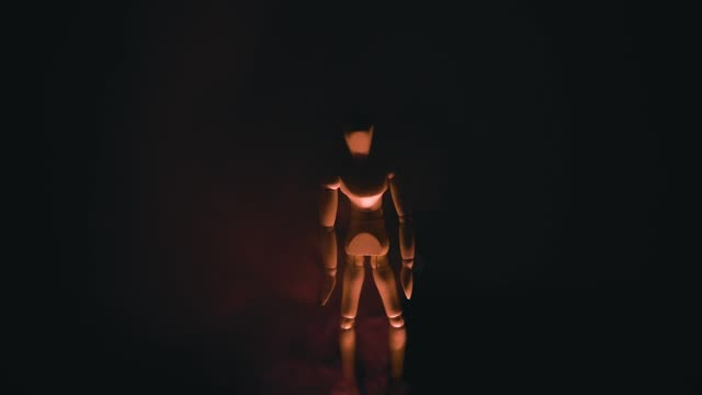wooden man on black background with backlight from below wooden man on black background with backlight from below 1 marionette stock videos & royalty-free footage