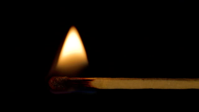 Wooden match burning horizontal, fire spreads left right sound video