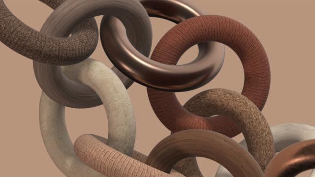 vídeos de stock e filmes b-roll de wooden, metallic, stone, fabric rings. close-up. 3d animation. - madeira material
