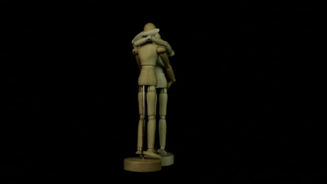 wooden model of human hug loop - family trees stock videos and b-roll footage