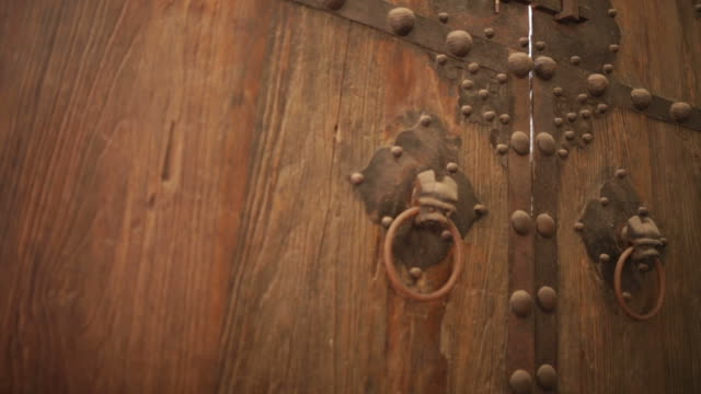 Wooden old fashioned door Wooden old fashioned door keyhole stock videos & royalty-free footage