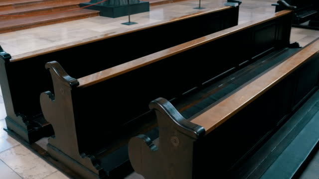 Wooden Pews in a Christian Church Aisle video