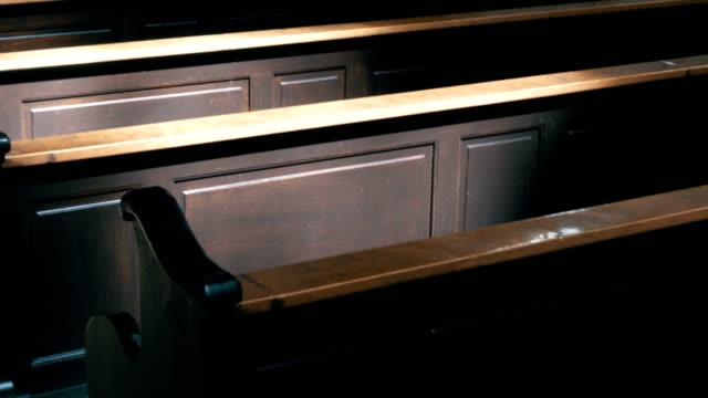 wooden pews in a christian church aisle - christening stock videos and b-roll footage