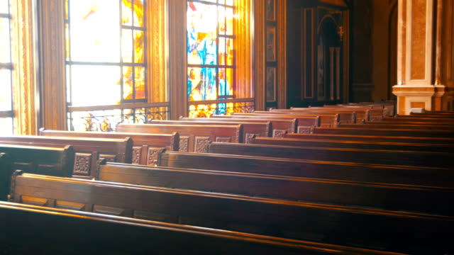 Wooden Pews in a Christian Church