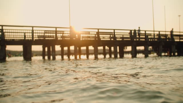 Wooden pier during sunset over the lake