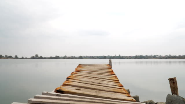 wooden pier on lake zooming video
