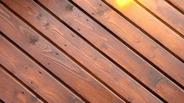 Wooden planks and boards background for your text slowly rotates and spinning 4k