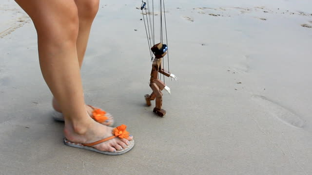 wooden puppet walking to the sea wooden puppet walking to the sea marionette stock videos & royalty-free footage