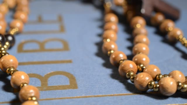 wooden rosary on the bible studio light religious text stock videos & royalty-free footage