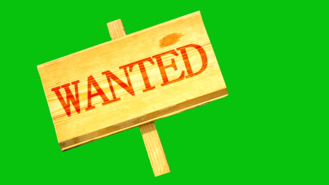 wooden sign with an inscription of wanted oscillates from side to side against the background of the green chroma key video