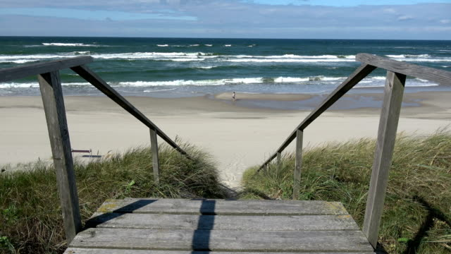 Wooden stairs on beach dune and Baltic waves