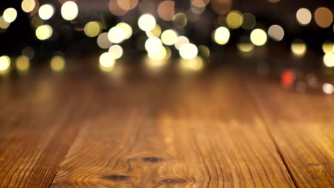 Wooden table background, Christmas light bokeh Wooden table background, Christmas light bokeh christmas tree stock videos & royalty-free footage