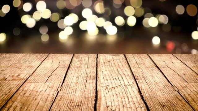 wooden table background, christmas light bokeh - christmas table video stock e b–roll
