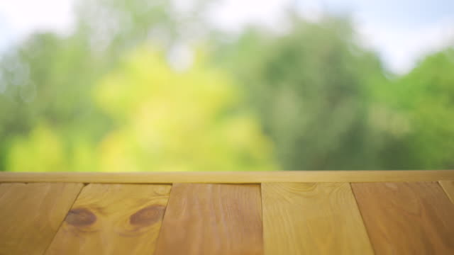 Wooden table top on colorful nature background