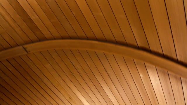 wooden texture of the roof moves - solar panel bildbanksvideor och videomaterial från bakom kulisserna