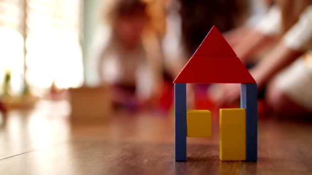 Wooden toy block house in children's bedroom video