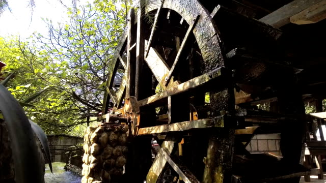 wooden water mill wheel spinning - vintage architecture stock videos & royalty-free footage