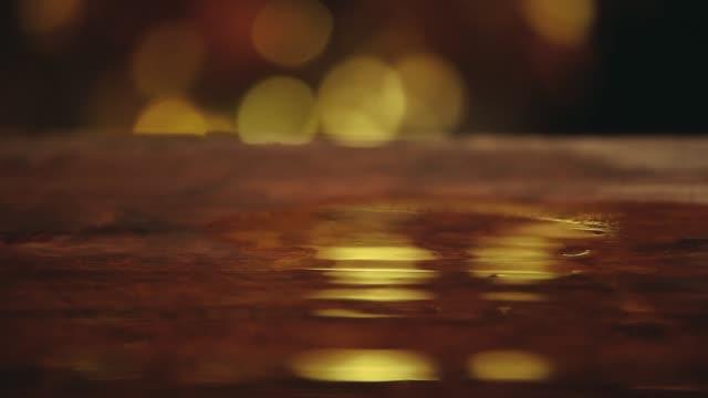 wooden wet table gold bokeh hd footage - drewno tworzywo filmów i materiałów b-roll