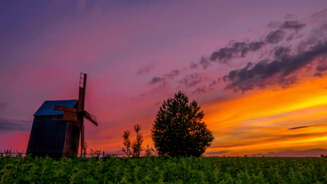 Wooden Windmill at Sunset video