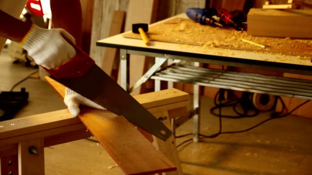 Woodwork and furniture making concept. Stylish craftsman working in his carpentry workshop video