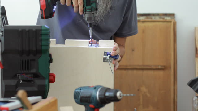 Woodwork, diy guy assembling plywood using screwdriver video