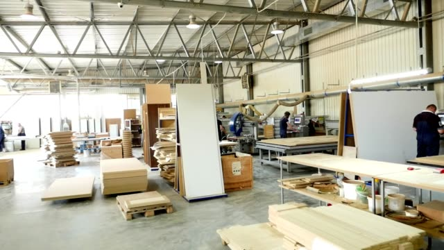 woodworking enterprise. production Department at a furniture factory. production, manufacture and woodworking industry concept - furniture factory workshop - vídeo