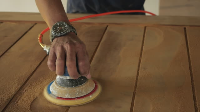 Woodworking. Sanding on wood in slow motion Woodworking. Sanding on wood in slow motion workbench stock videos & royalty-free footage