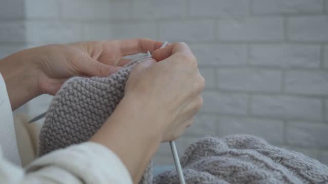 Wool needlework.