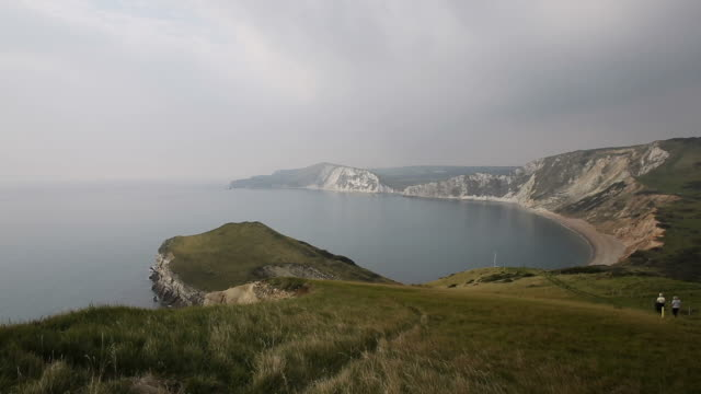 Worbarrow Bay east of Lulworth Cove on the Dorset coast England uk pan Worbarrow Bay east of Lulworth Cove on the Dorset coast England uk pan view east stock videos & royalty-free footage