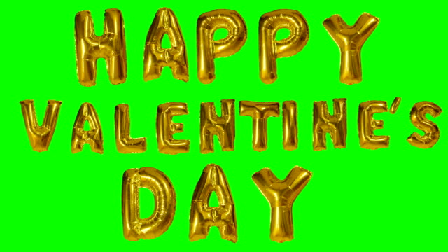 word happy valentine day from helium golden balloon letters floating on green screen - metallizzato video stock e b–roll