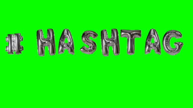 Word hashtag from helium silver balloon letters floating on green screen