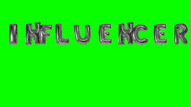 Word Influencer from helium silver balloon letters floating on green screen