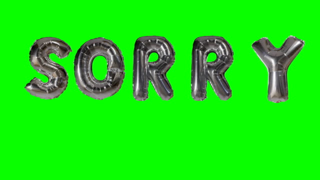 word sorry from helium silver balloon letters floating on green screen - wine filmów i materiałów b-roll