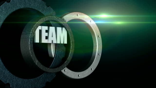 Word team in rotating gear wheel with flare, teamwork business concept