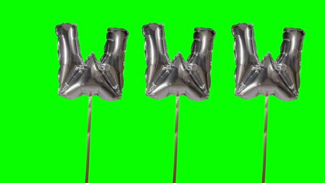 word www web internet från helium silver ballong bokstäver flytande på grön skärm - stavning bildbanksvideor och videomaterial från bakom kulisserna