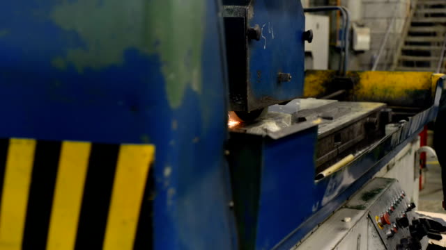 Work of an industrial surface grinding machine. Grinding of a flat metal part video
