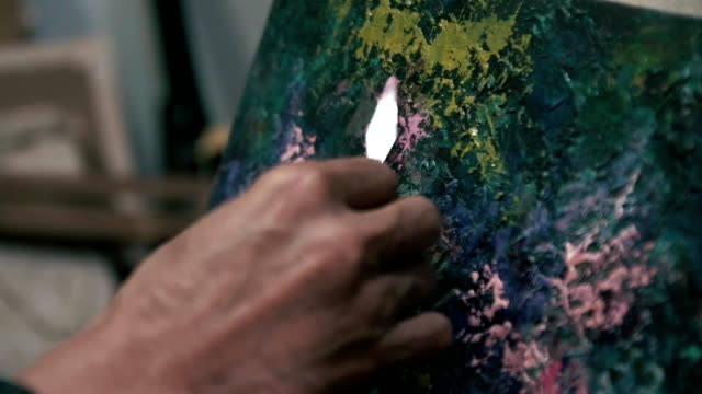Work with palette knife. The work of a professional (close-up) video