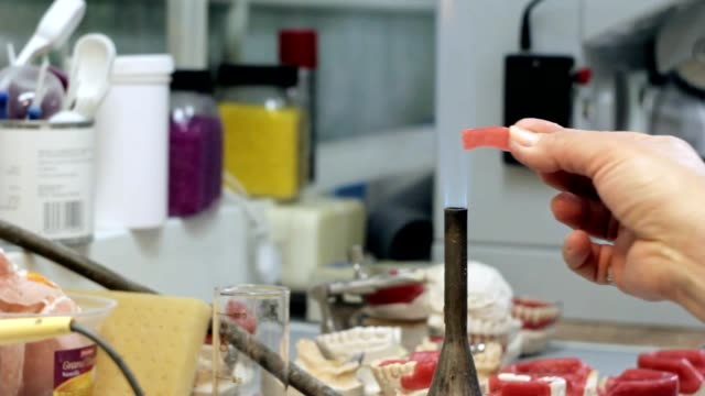 Work with the burner in the dental laboratory video