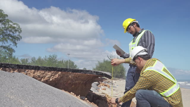 4K DOLLY : Worker and engineer inspection 4K DOLLY : Worker and engineer inspection the road damaged by erosion quality control stock videos & royalty-free footage