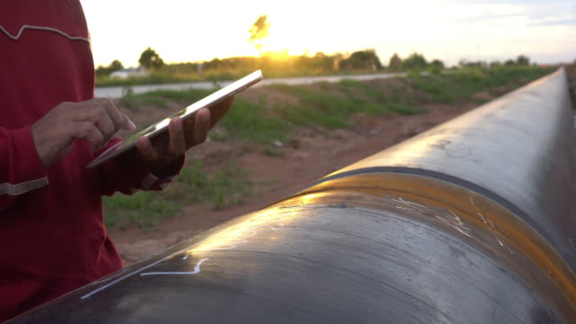 Worker and Pipelines Worker and Pipelines gas pipe stock videos & royalty-free footage
