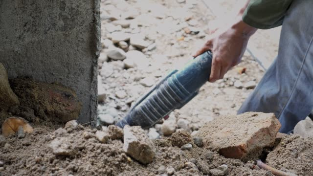 Worker builder making construction with screwdriver drill video