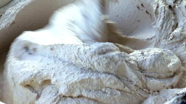 worker builder mix cement in bucket. video
