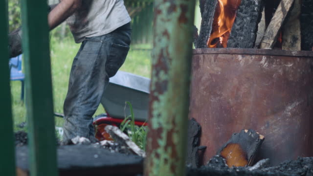 worker burning construction garbage - imperfection stock videos & royalty-free footage