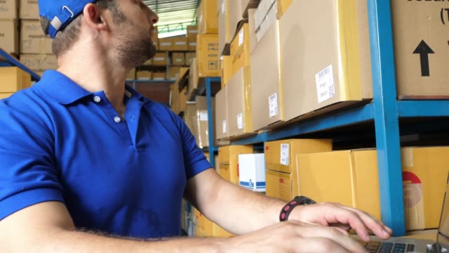 Worker checking stock for shipping to customer