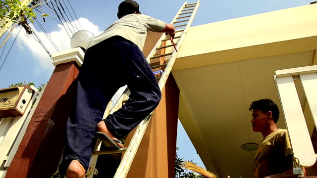 Worker climbing staircase on construction home video