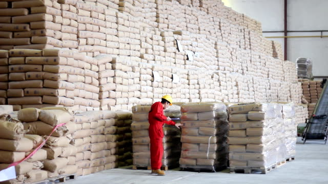 Worker controls of sugar in bags video
